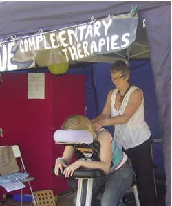 Jacky doing seated acupressure massage in the Chill Out Zone